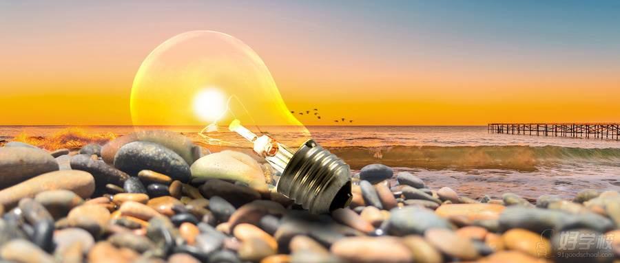 摄图网_500633535_wx_海边石头堆上发光的灯泡(企业商用)